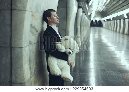 Man Is Sad With A Teddy Bear Toy In His Hands. The Concept Of His Beloved Woman Did Not Come To The