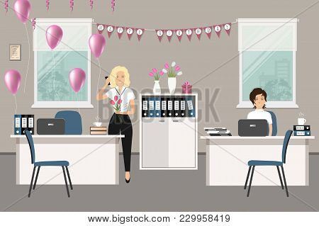 Workplace Of An Office Worker, Decorated For His Birthday. Young Woman Is Stands With A Bouquet Of F