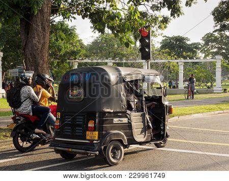 Colombo, Sri Lanka - November 11, 2017: Unidentified Men On Motorcycle And Three-wheeled Taxi Stop O