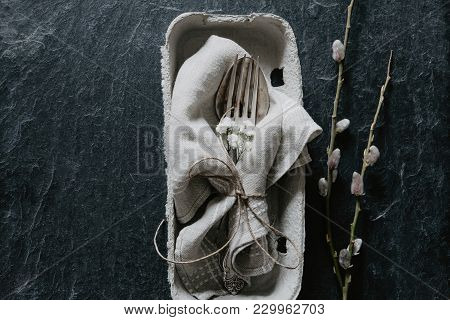Natural Easter Table Decoration With Silverware In Egg Box On Black Stone With Fluffy Willow