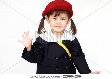 Japanese Girl In Kindergarten Uniform Waving Her Hand (3 Years Old)