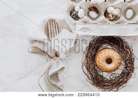 Spring Easter Table Setting With Silverware, Napkins And Muffin In A Wreath