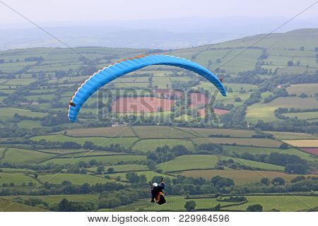 Paraglider Flying In The Brecon Beacons In Wales