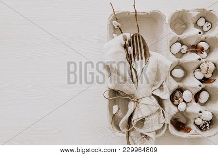 Spring Easter Table Setting With Silverware, Napkins And Feathers, Copy Space