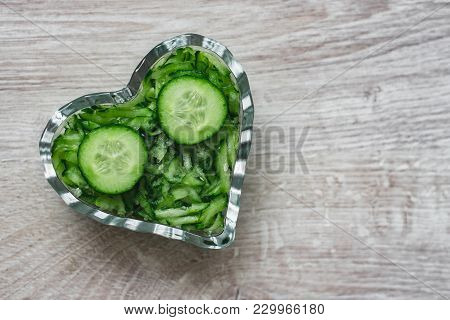 Still Life Culinary Decorations, Vegetarian, Natural And Healthy Food Grated And Sliced Cucumber In