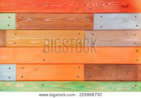 Colorful Wooden Plank Background. Orange, Red Planks Texture