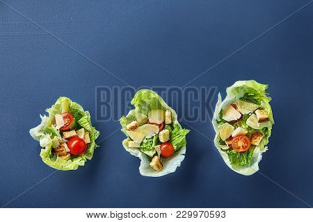 Yummy Top View Composition Of Fresh Healthy Salad Artistically Served On Lettuce Leaves On Dark Back