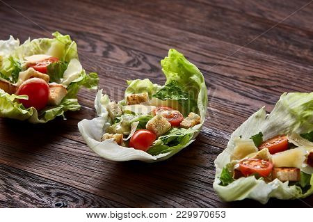 Yummy Top View Composition Of Fresh Healthy Salad Artistically Served On Lettuce Leaves On Vintage W