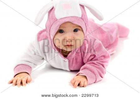 Portrait of four mounth baby age of four mounth lying on the floor wearing bunny suit isolated on white poster