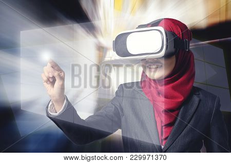 Creative Ideas Concept, Successful Young Muslimah Businesswomen Wearing Virtual Reality Headset  Ove