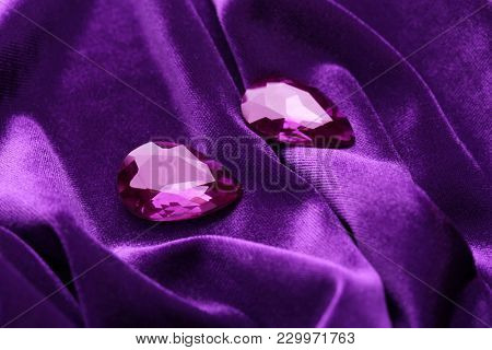 Precious stones for jewellery on purple velvet