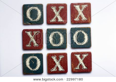 Tic Tac Toe Wooden Blocks on a White Background