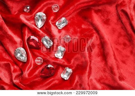 Precious stones for jewellery on red velvet