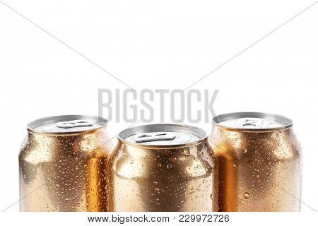 Cans of beer on white background, closeup