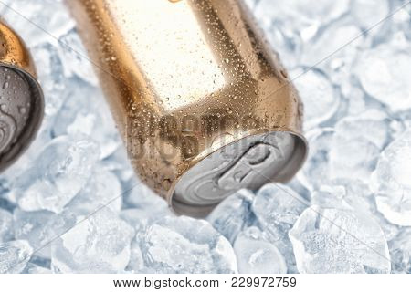 Can of fresh beer on ice, closeup