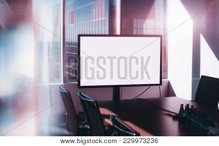Template Of Empty White Presentation Screen At The Head Of The Table In Modern Office Meeting Room,