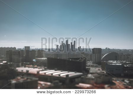 True Tilt-shift View From The High Point Of The Cityscape On A Sunny Day With The City Center And Th
