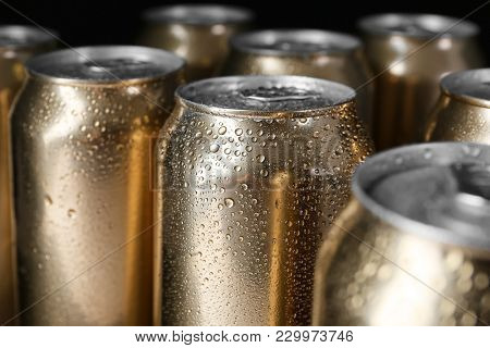 Cans of beer with drops of water, closeup