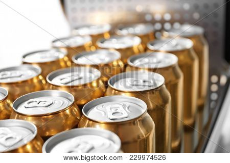 Cans of beer in brewery, closeup
