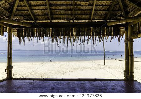 Beautiful Tropical Beach With White Sandy Beach From Bamboo Hut. Beach Volley Ball Net On Background