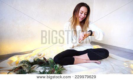 Beautiful Girl Communicates Using Modern Smart Watch And Tests G