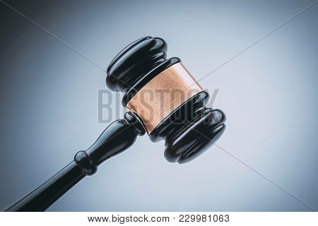 Black Judge Wood Hammer With Blue Background.