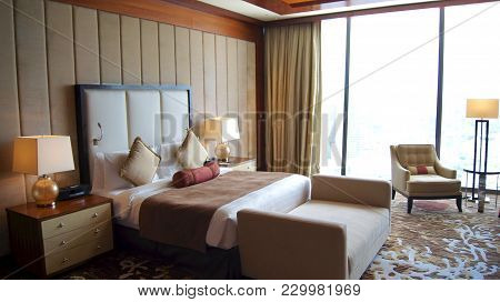 Singapore - Apr 2nd 2015: Beautiful Master Bedroom With View In A Luxury Hotel Room Of The Marina Ba