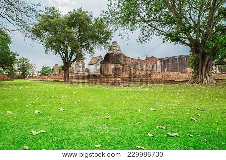 Gardeners Clean The Area Around The Ancient Trees And Temple Wat Si Sawai Inside Sukhothai Historica