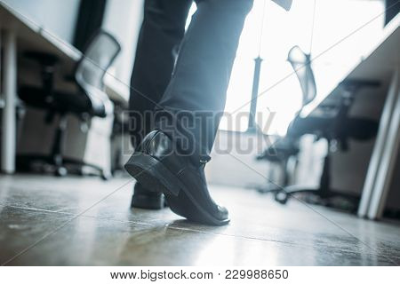 Partial View Of Businessman Walking In Office