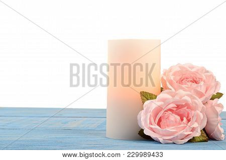 Closeup Roses And Candle On Blue Wood