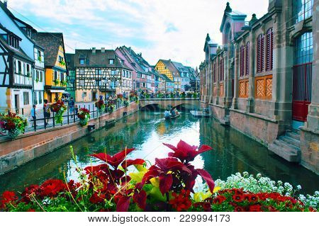 Colmar, France - July, 2017: The Petit Venice District The Water Canal And Traditional Colorful Hous