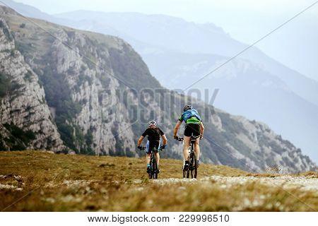Mountain Biking Two Men On Sport Bikes Cycling Race