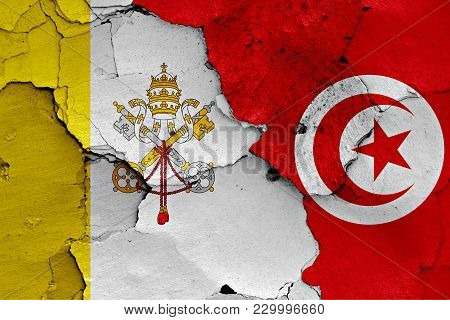 Flag Of Vatican And Tunisia Painted On Cracked Wall
