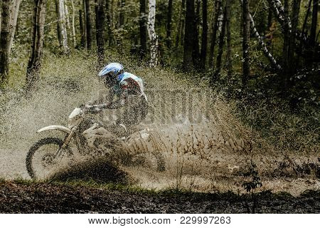 Enduro Motorcyclist Splashes Of Mud And Water Motocross Race