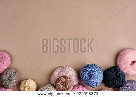 Set Of Colorful Wool Yarn On Beige Background. Knitting As A Kind Of Needlework. Colorful Balls Of Y