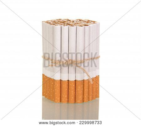 Bunch Of Cigarettes Tied With String And Stand Upright Isolated On White Background