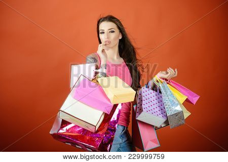 Fashion, Beauty, Style, Vogue. Woman Shopaholic With Paper Bags, Sale. Present, Gift, Holidays Celeb