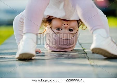 Activity, Energy Concept. Girl Stand On Head On Sunny Day Outdoor. Sport, Yoga, Pilates For Child. C