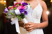 Rose bouquet held by one unrecognizable teenage girl getting ready for prom poster
