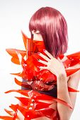 Cosplay, Asian woman cosplayer with futuristic costume in red, made with pvc plastics and transparencies. oriental girl poster