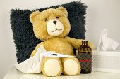 Plush bear is sick, has  rhinitis and temperature 39°C.Plush bear with thermometer and bottle with MEDICINE inscription. poster