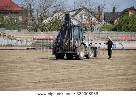 Slavyansk-on-kuban, Russia - April 25, 2019: Repair Work At The Stadium. Delivery And Leveling Of Sa