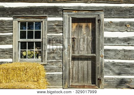 Window And Door Of A Very Old Cabin