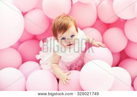 Beautiful, 11 Month Baby Girl Standing Among Pastel Pink Balloons