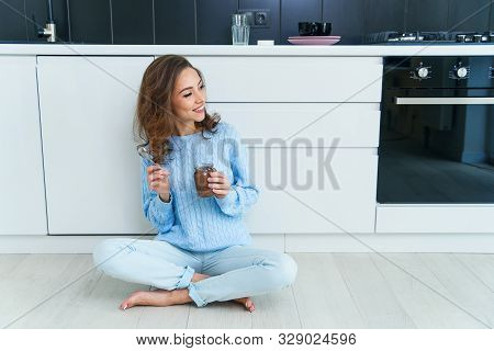 Pretty Exuberant Young Woman In Modern Stylish Clothes Enjoying Tasty Chocolate And Looking At Camer