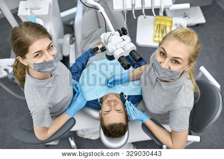 Male Patients Teeth Treatment In Dental Clinic