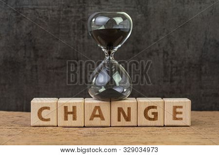 Change, Transform Or Evolve Concept, Sand Glass Or Hourglass On Cube Block With Alphabet Building Th
