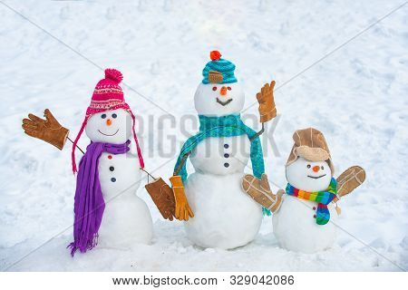 Winter Time Scene. Snowmen. Christmas Background With Snowman. Christmas Snowman Close Up With Scarf