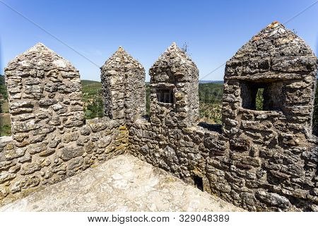 Detail Of The Merlons, Crenels And Arrow Loops Of The Castle Of Penela, Built In The 12th Century In