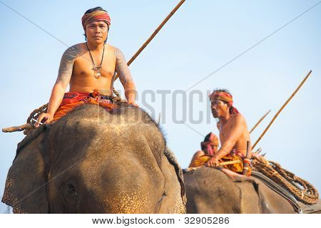 Elephant Trainers Riding High